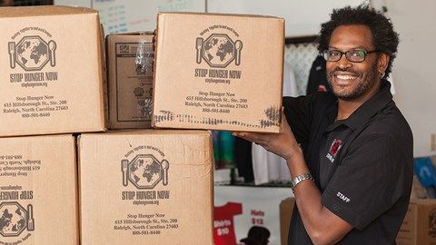PULSE Volunteer working with boxes