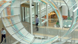 Employees walking across a bridge at GSK House, UK