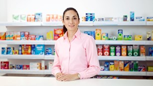 Dawn, pharmacist with pharmacy products on shelves in our Shopper Science Lab