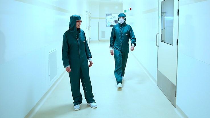 Scientists in green uniforms